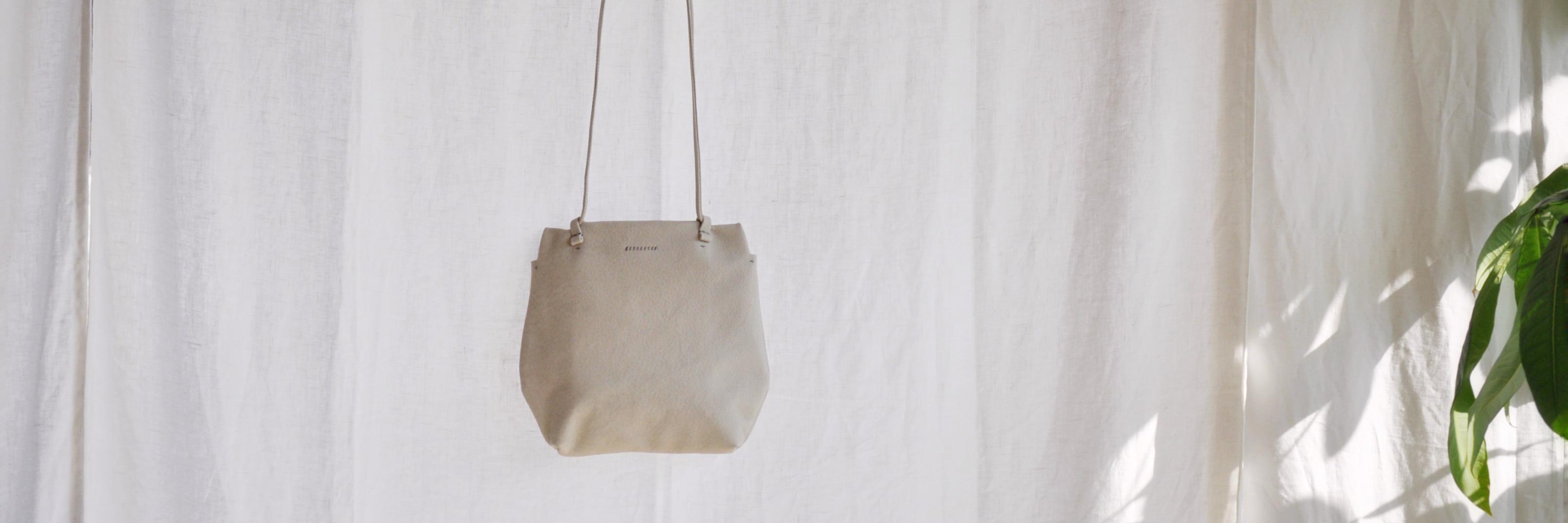 白いバッグ、六角形のバッグ